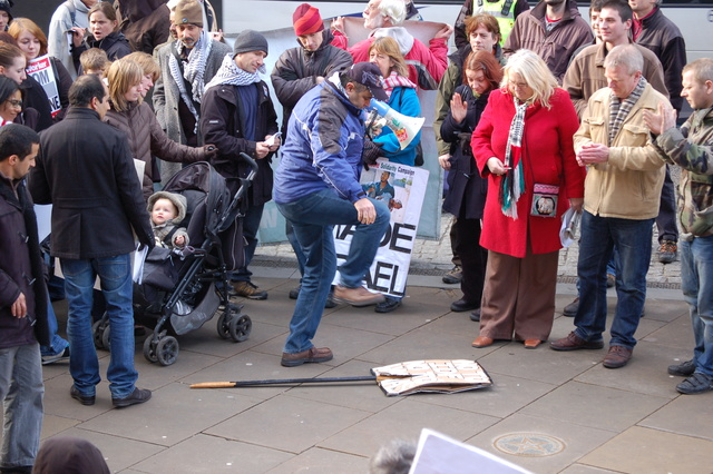 """""""No to IDF, No to Hamas"""" placard is trampled underfoot"""